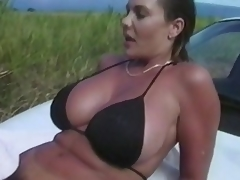 No thing can stop this couple to do some tricky fucking.  Here they are, in the grassy outdoor... trying to do an adventurous fuck again, and satisfy their cravings.  There's more... take a little peep as they try to fuck right on top of the car, below the