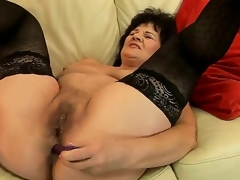Sweet granny Helena May is getting her cunt and anal tunnel pleasured with sex toys simultaneously