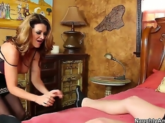 Raquel DeVine seduces Xaner Corvus and shows him how a spruce MILF works a dick. She keeps her nylons on as this babe blows him and gives him a titjob before jumping on his pecker for a ride.