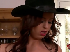 Sirale returns to our site to bedazzle our brains and boners with her jugs. This time the bosomy Czech is in a darksome suit and a cowboy hat as this babe looks on a dining room shelf.