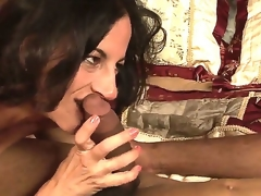 Lusty turned on dark brown milf Melissa Monet with natural hanging meatballs gives head to dirty dark fellow and rides on his schlong in bedroom while her hubby is at work.