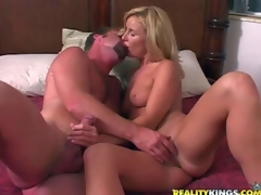 Attractive blonde milf gets her juicy boobies touched by curious guy previous to that hottie takes off her hawt white panties. They warm each other up and then that hottie swallows his rock hard dong