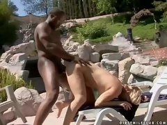 Lusty pale blonde cougar with big bouncing arse and juicy tits gives head to black hunk and receives pounded hard from behind to loud agonorgasmos in backyard on a sunny day