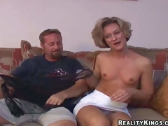 Sexy slim mature brunette milf with small wobblers and fit body in short white skirt and undies has pleasure with her ribald neighbour and takes on his beefy jock in living room