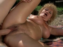Large breasted oldie Effie enjoys sex with hard dicked youthful stud in nature. Breasty granny in barely there bikini top gets her loose twat pounded on the wild beach. She is horny for her youthful paramour