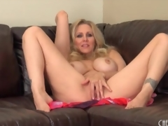 Milf Julia Ann strips nude and sensually masturbates
