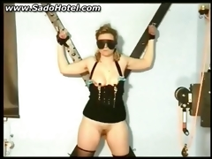 Slave tied to a wall acquires clamps on her nipps and her love tunnel licked by her master BDSM