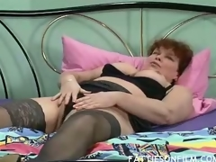 Barbara was just getting ready for daybed but stripping her clothes off and seeing her hawt black stockings actually made her horny. She then begins massaging her juicy jugs and finger fucking her bushy box to orgasm.
