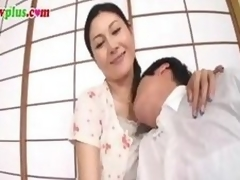 Censored movie scene of a Japanese MILF gender a much younger fellow